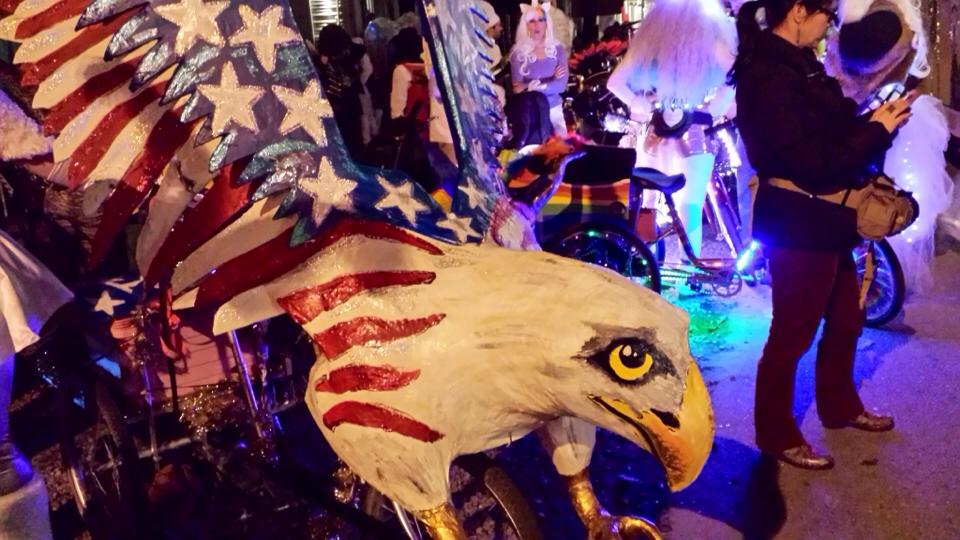Parade upon this eagle art bike Mardi Gras float built by the Krewe of Kolossos.