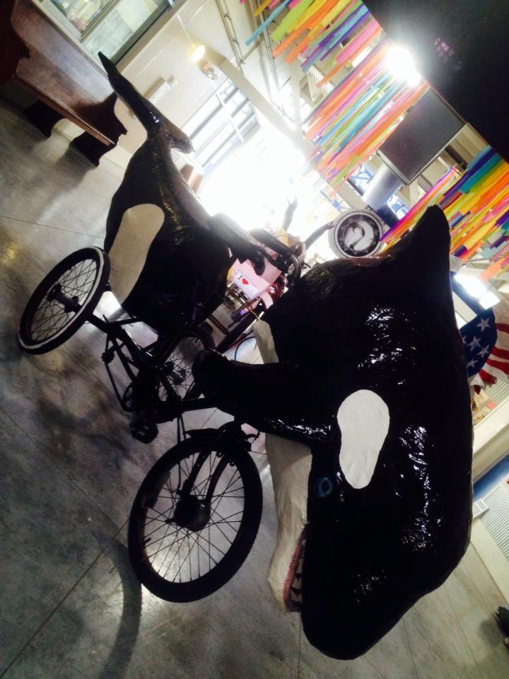 Parade upon this orca whale art bike Mardi Gras float built by the Krewe of Kolossos.