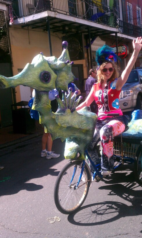 Artist, author and arts educator Lola Lombard gets in the Kolossos spirit while visiting New Orleans for French Quarter Festival.